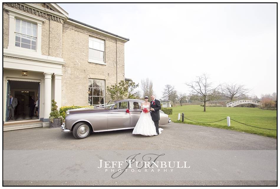 Bride and Groom by the car at the Fennes Wedding venue