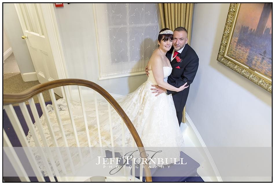 Bride Groom on Staircase Fennes Wedding venue