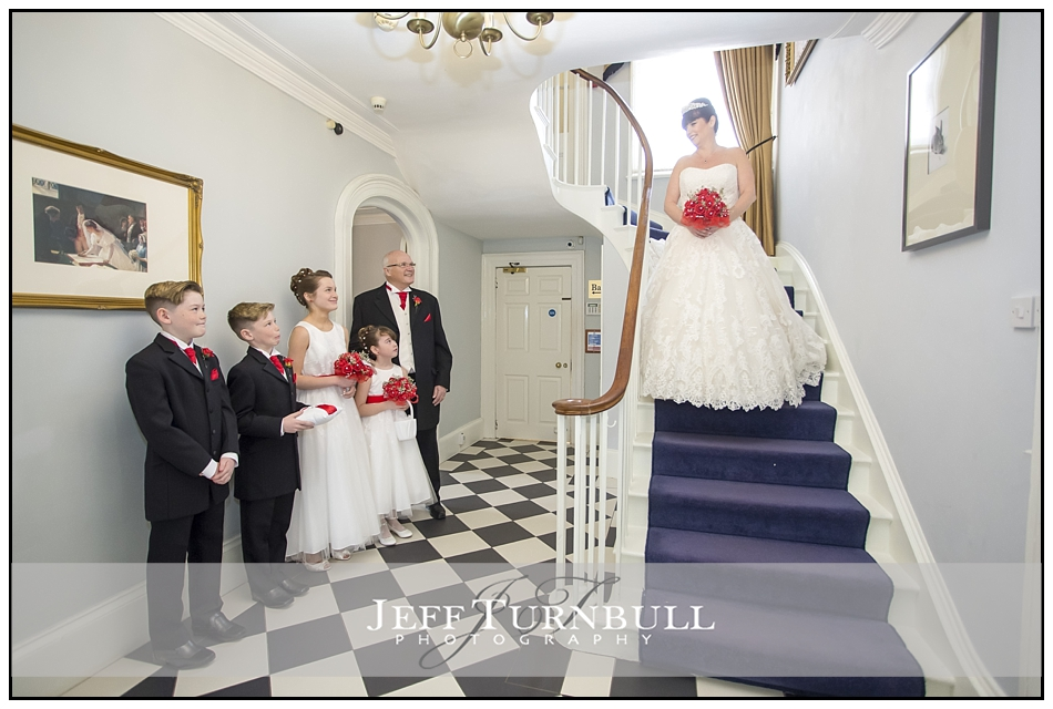 Bride coming done stairs at the Fennes Wedding venue
