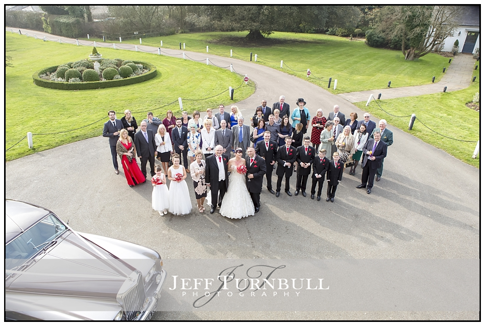Group photo from window the Fennes Wedding venue