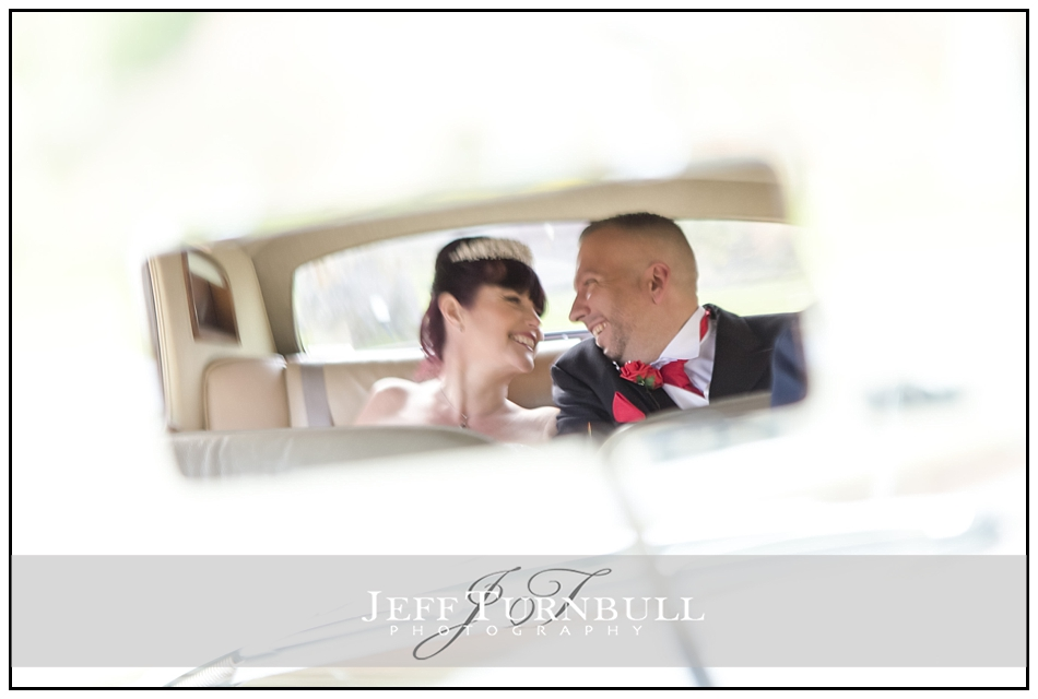 Bride and Groom in the car the Fennes Wedding venue