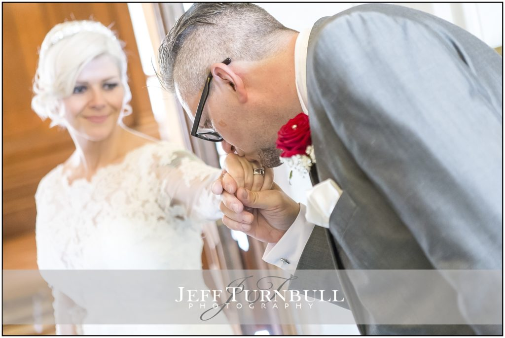 Groom kissing his Bride on the Hand