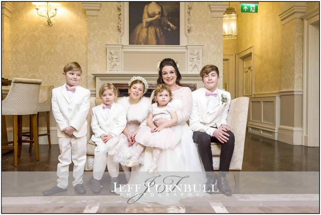 Bride and Children Down Hall